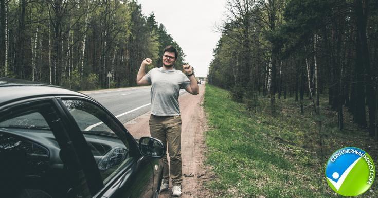 man streaching near car after long drive