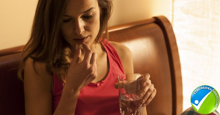 Young Woman Pyjamas Taking Sleeping Pill